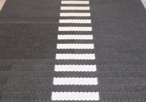 Jaguar mat with marking studs